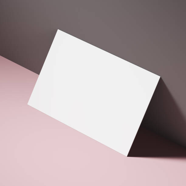 white business card on a pink table - business card stock photos and pictures