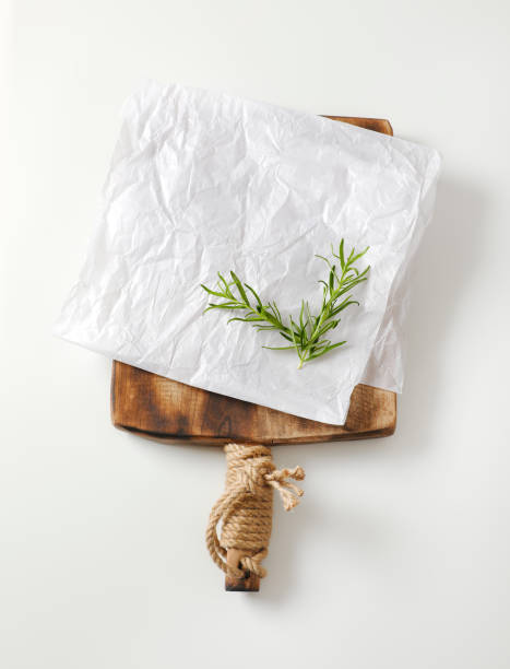 White butcher paper on cutting board stock photo