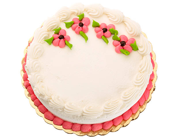 White Butter Cream Frosted Cake, Decorated With Pink Flowers stock photo