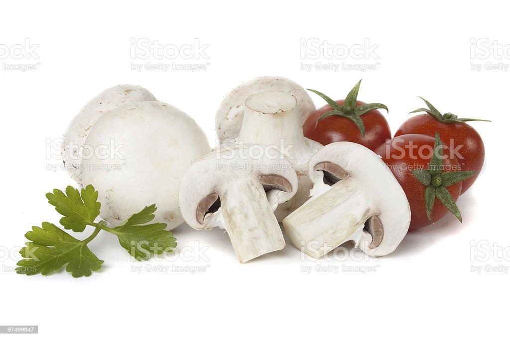 White button mushrooms with cherry tomato royalty-free stock photo