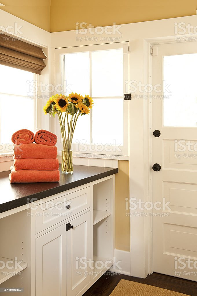 White cabinets in a laundry room stock photo