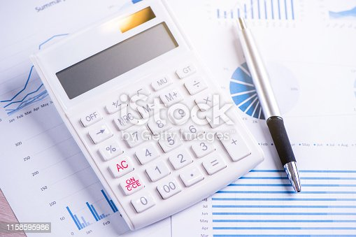 istock White calculator and report with chart and graph, concept of annual financial profit overview, banking and investment, copy space, macro, close up 1158595986