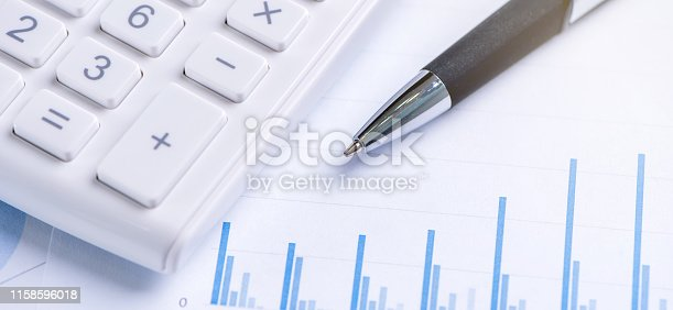 istock White calculator and report with chart and graph, concept of annual financial profit overview, banking and investment, copy space, macro, close up 1158596018