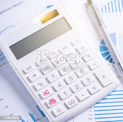 istock White calculator and report with chart and graph, concept of annual financial profit overview, banking and investment, copy space, macro, close up 1158596057