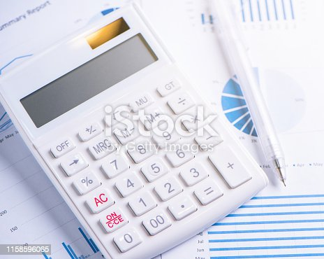 istock White calculator and report with chart and graph, concept of annual financial profit overview, banking and investment, copy space, macro, close up 1158596065