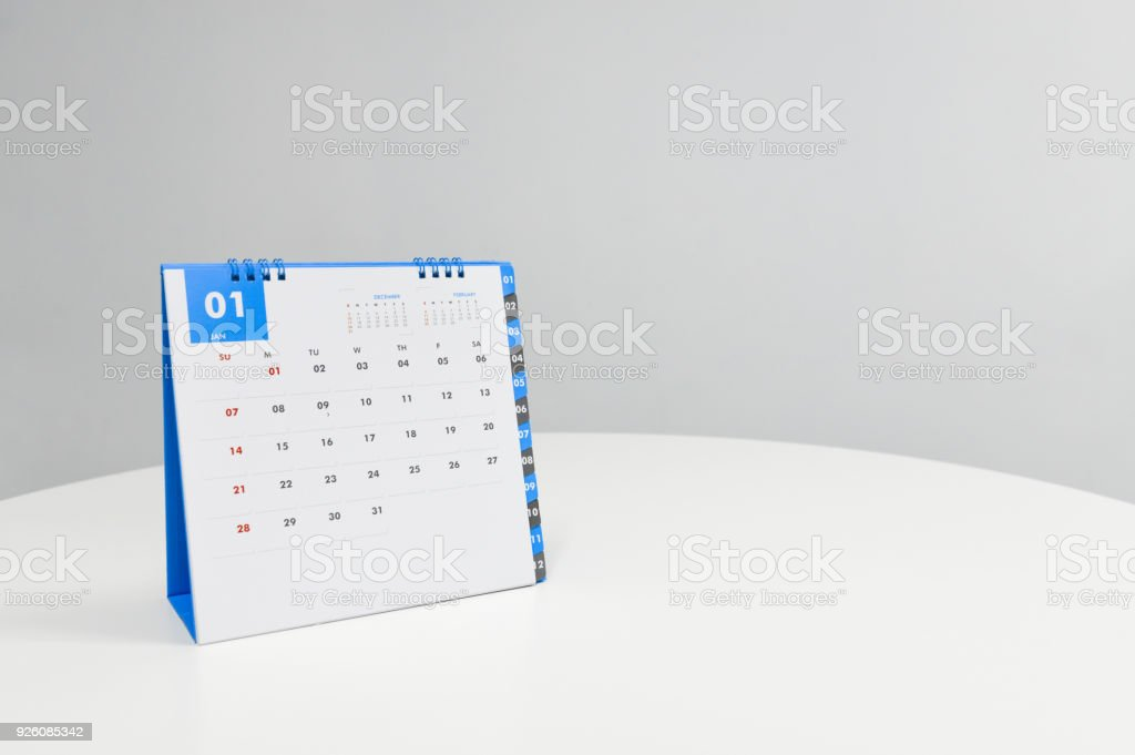 White calendar of January on the white table stock photo