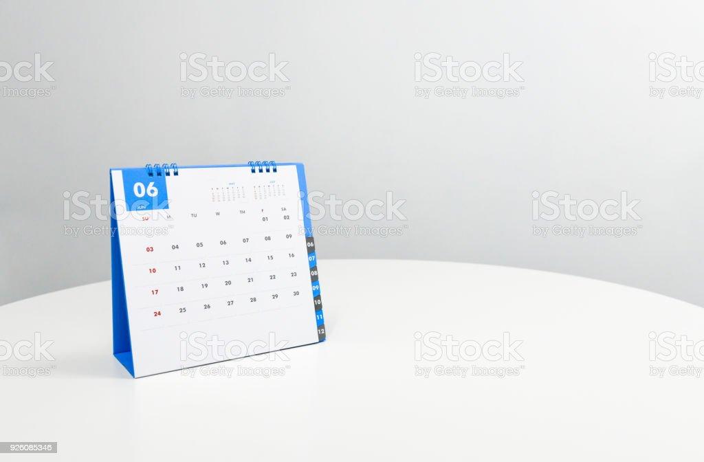 White calendar of June on the white table stock photo