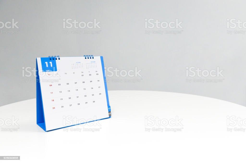 White calendar of November on the white table stock photo
