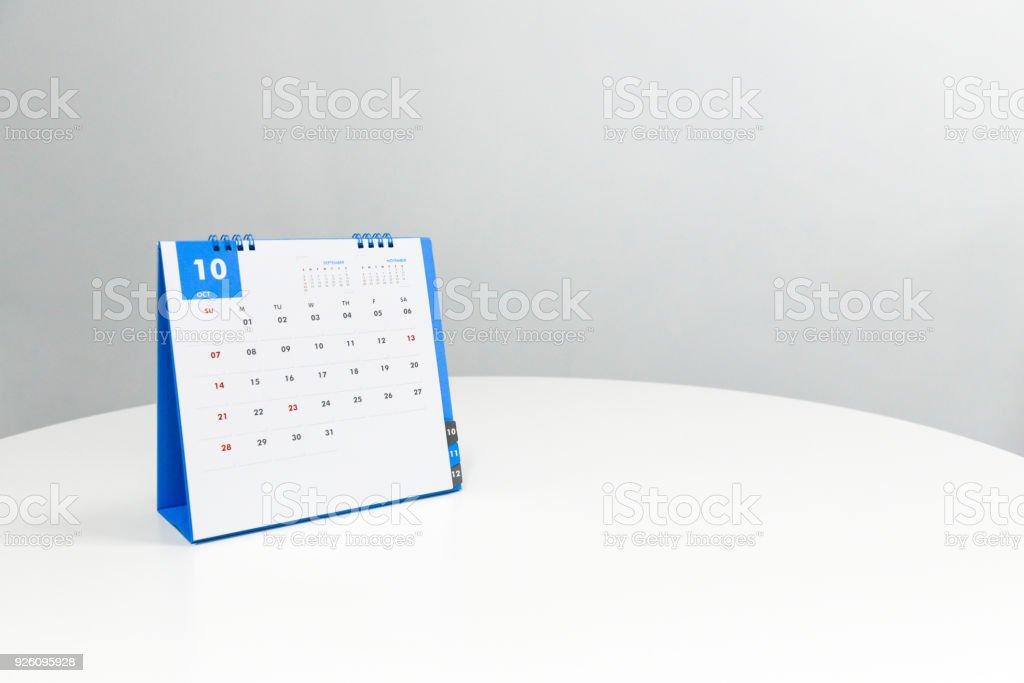 White calendar of October on the white table stock photo