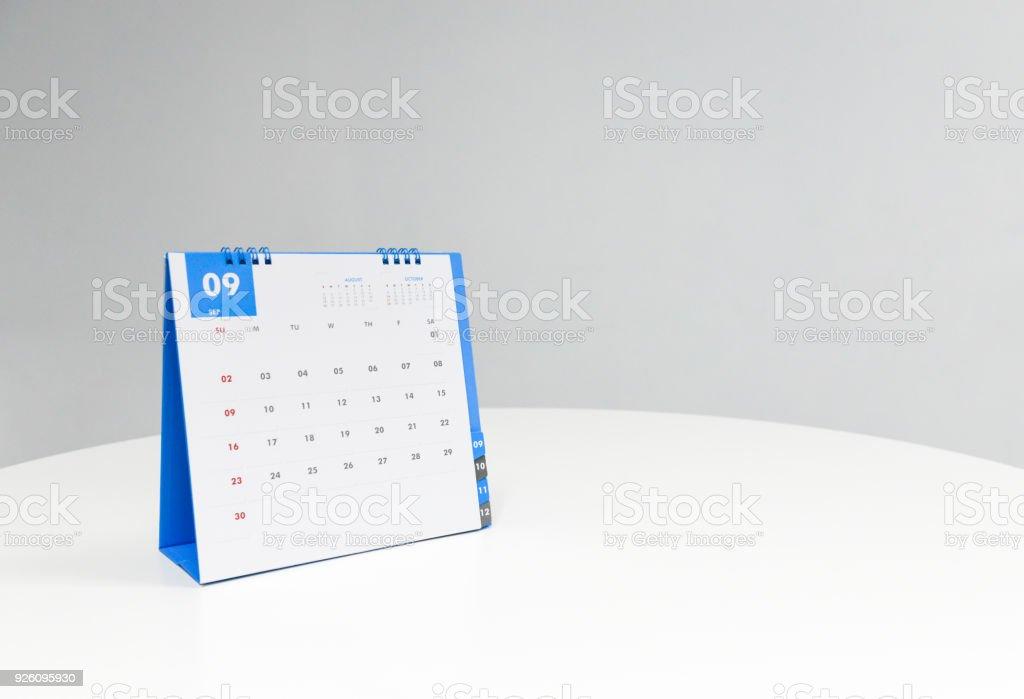White calendar of September on the white table stock photo