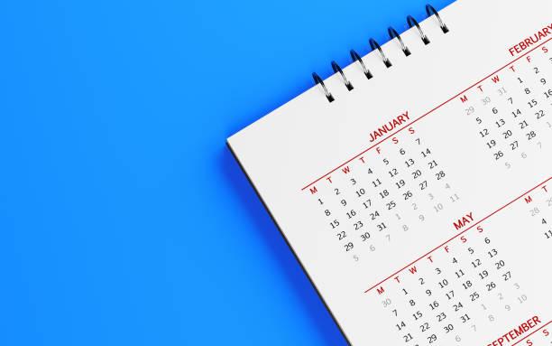 White Calendar On Blue Surface stock photo