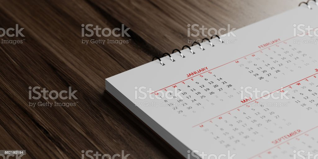White Calendar On  Brown Wood Surface stock photo