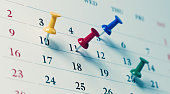istock White Calendar With Colored Push Pins Showing Important Dates 1194395223