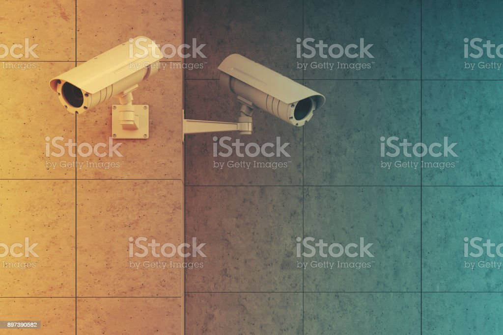 White cameras on a gray wall toned stock photo