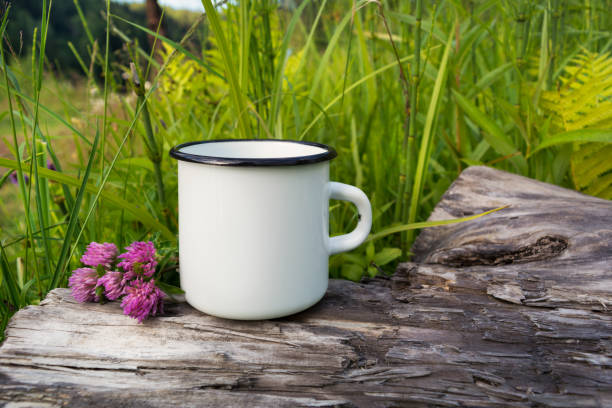 White campfire enamel mug mockup with red clover stock photo