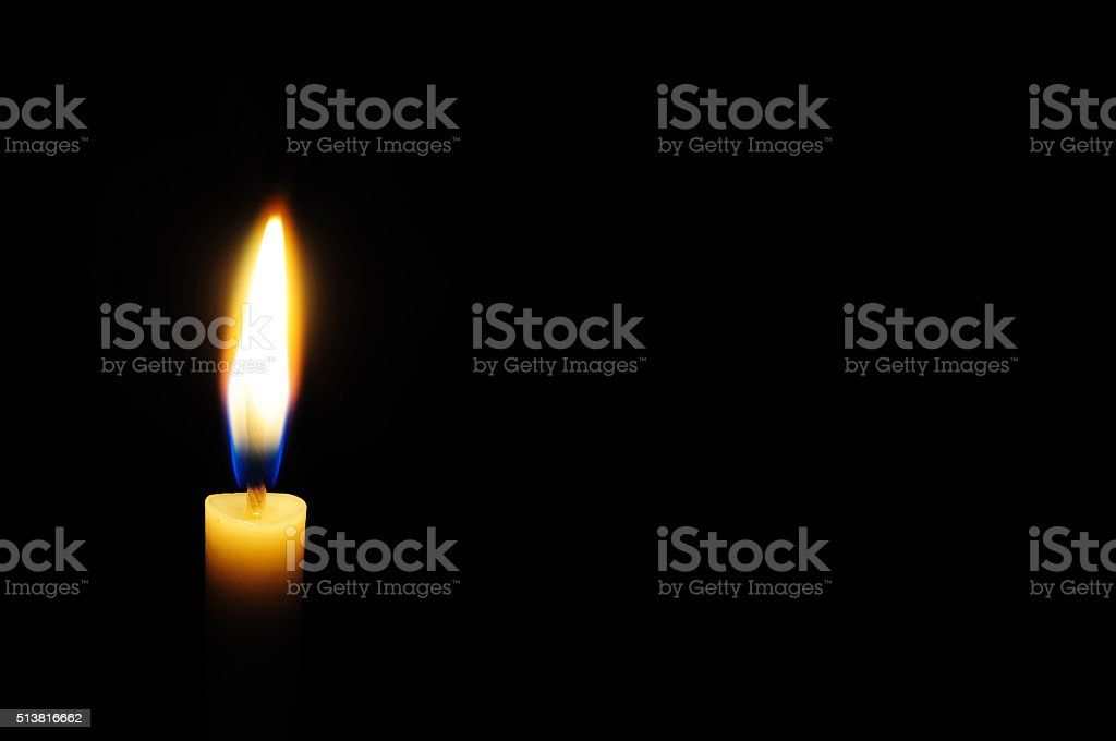 White candle light with black background stock photo