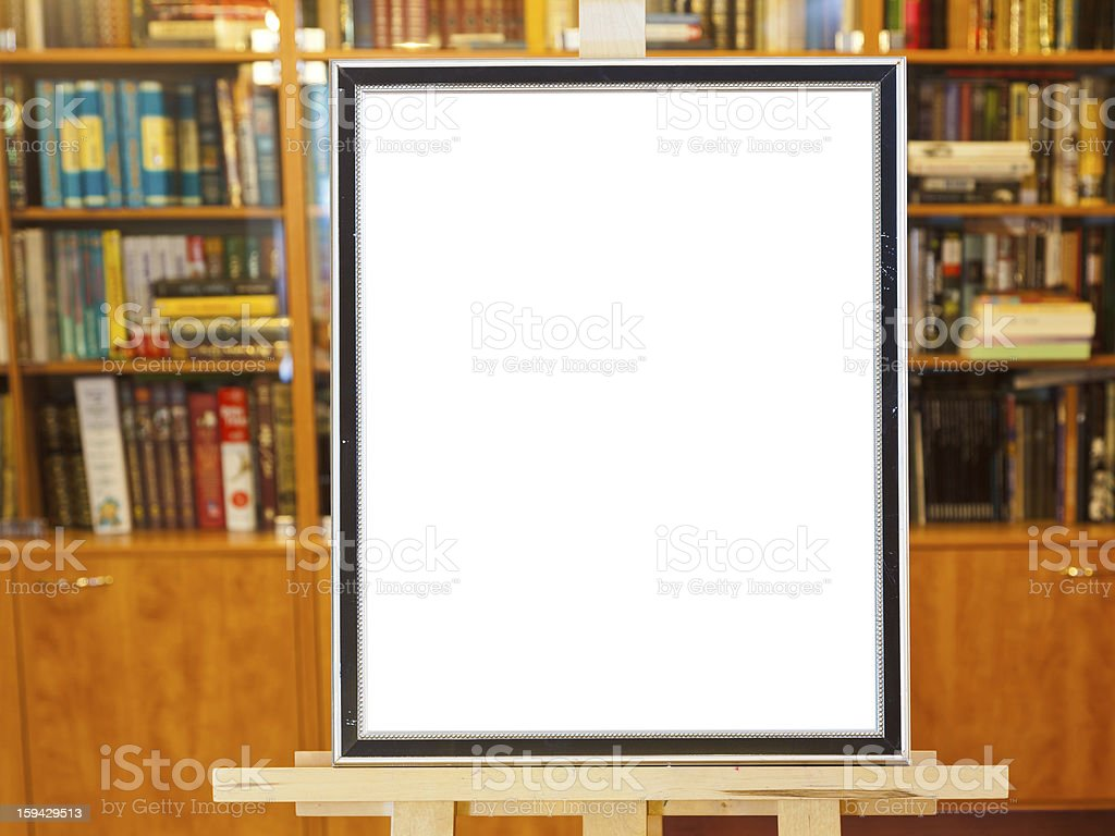 white canvas of picture frame on easel in library royalty-free stock photo