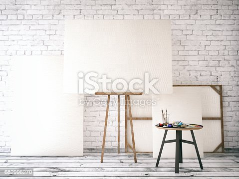 Easel with canvas on a grunge brick wall