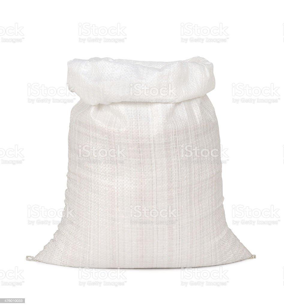 White canvas con un saco de paddy - foto de stock