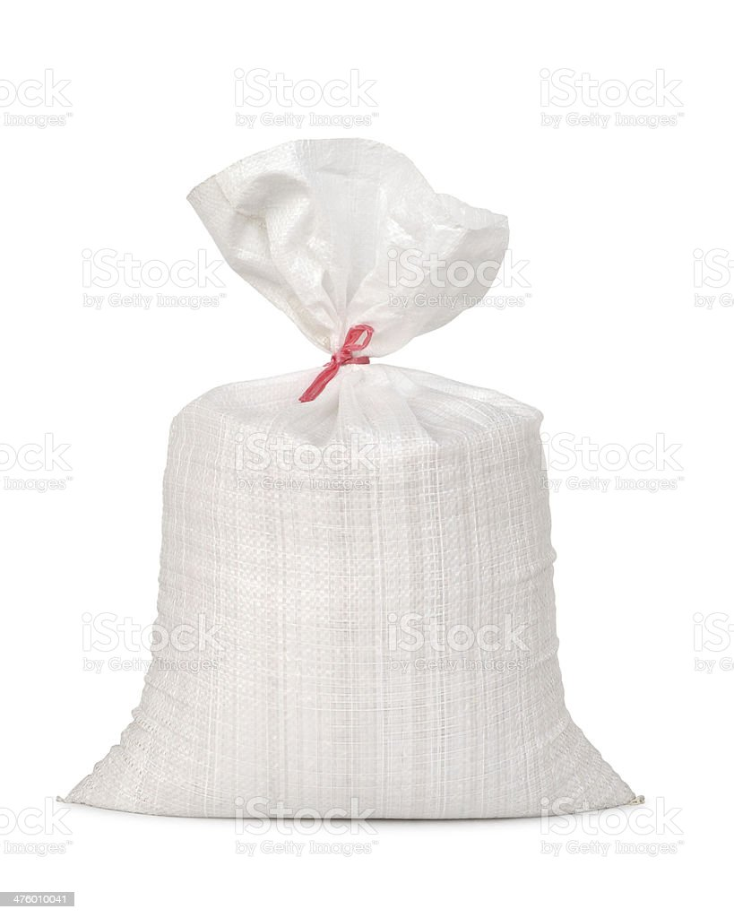 White canvas sack with full paddy stock photo