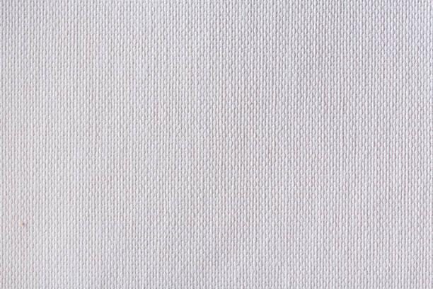 beyaz bez doku yakın çekim - tuval tekstil stok fotoğraflar ve resimler