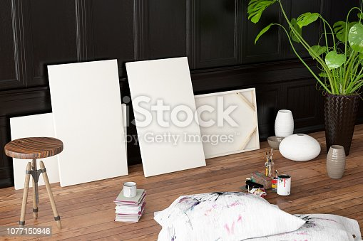 936286060 istock photo White Canvas with Painting Tools 1077150946
