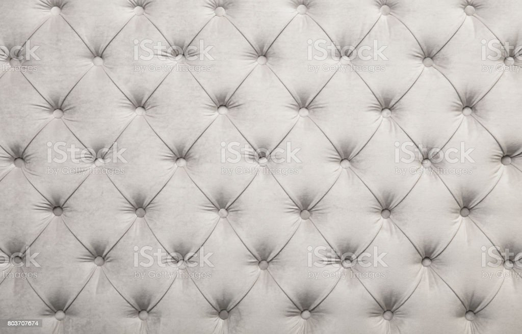 White capitone tufted fabric upholstery texture stock photo