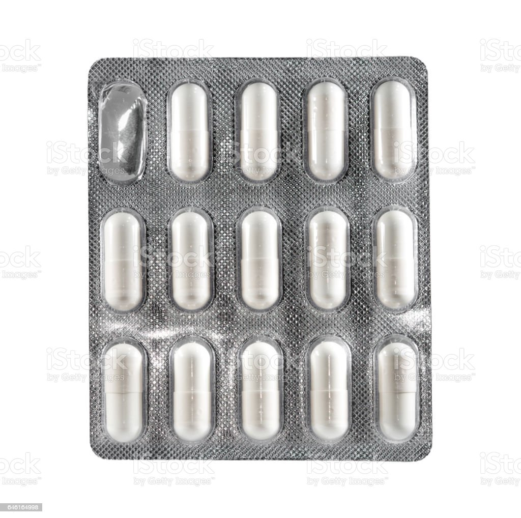 white capsule in blister package stock photo