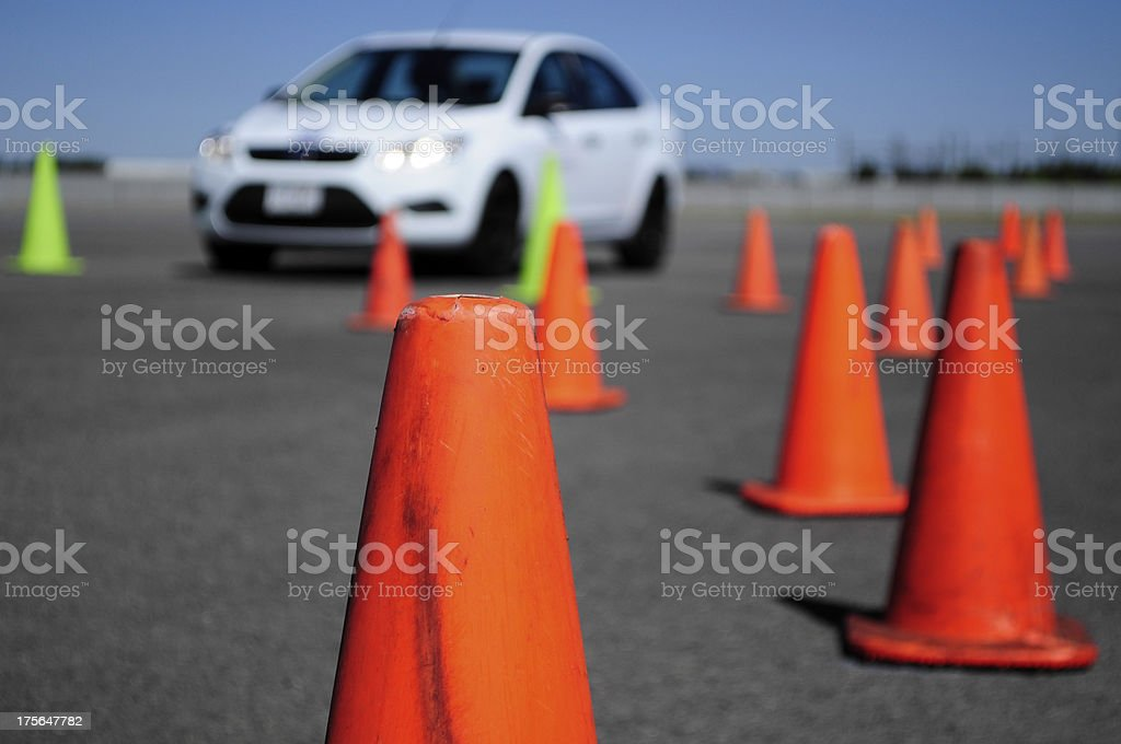 White Car and many traffic orange cones stock photo