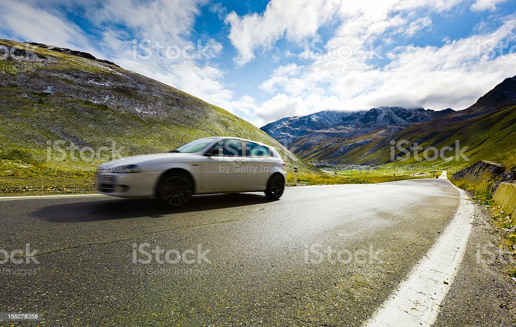 White Car Driving fast in the Alps Country Road royalty-free stock photo