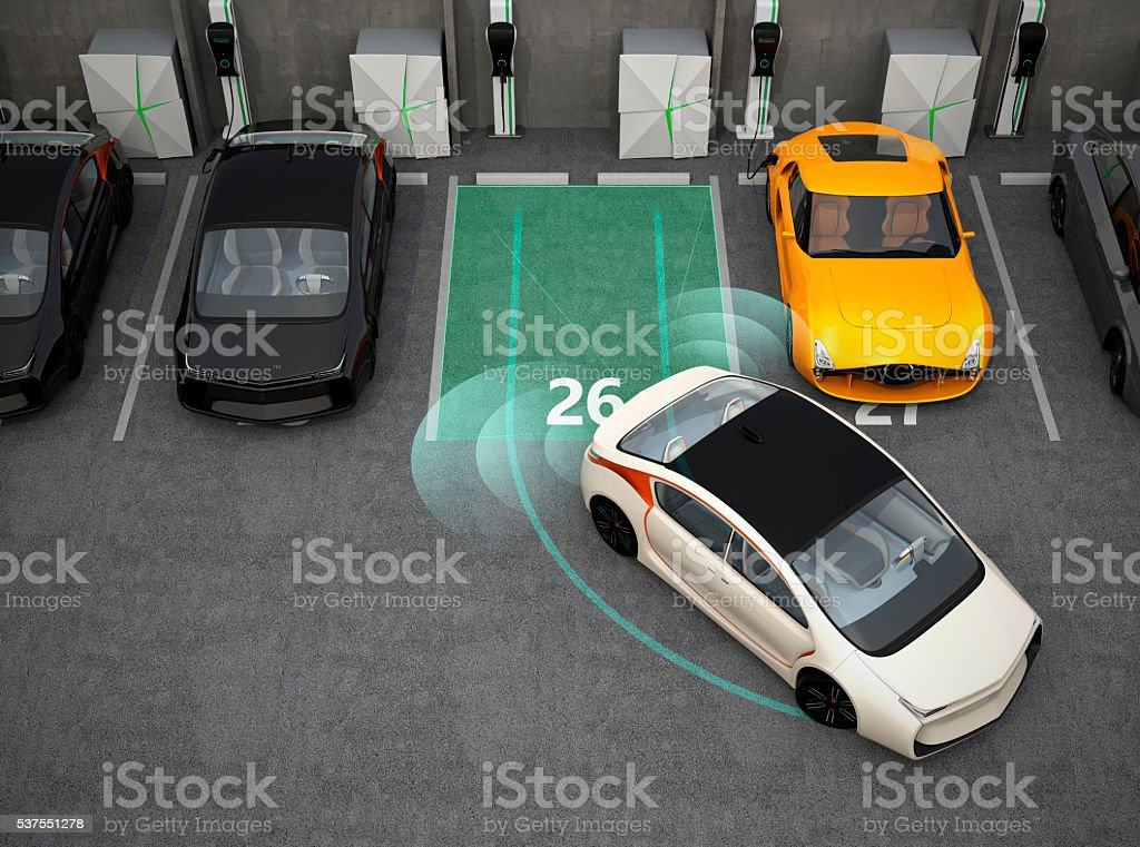 White car driving into parking lot with parking assist system stock photo