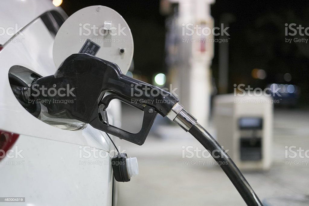White Car Getting Gas at the Station stock photo