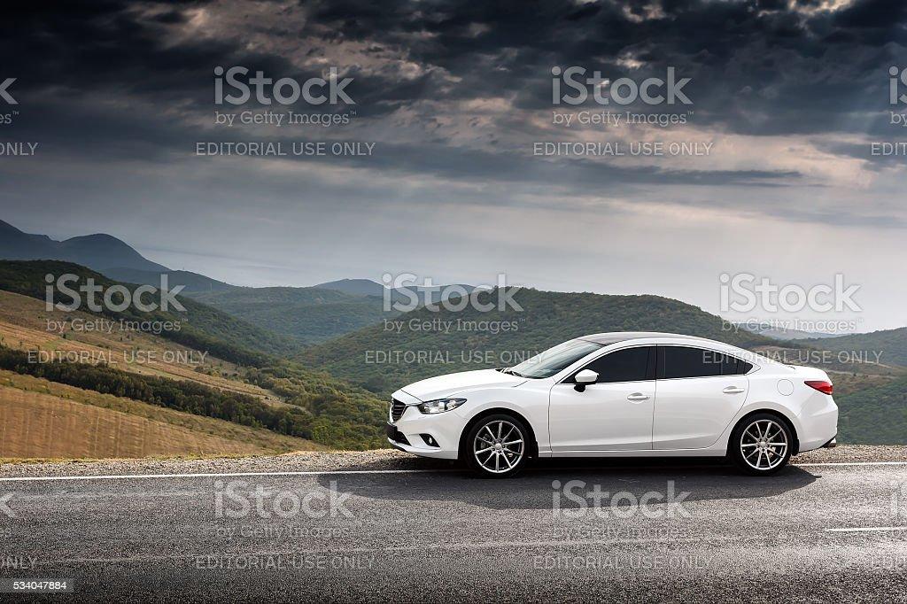 White Car Mazda 6 parket at countryside asphalt road stock photo