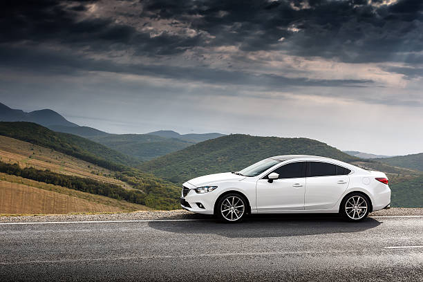 White Car Mazda 6 parket at countryside asphalt road stock photo