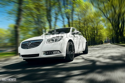 Moscow, Russia - May 07, 2015: Car Opel Insignia drive at asphalt forest road at daytime