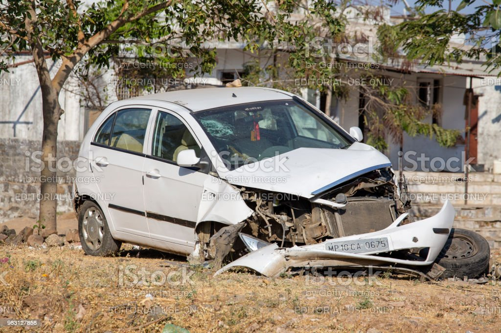 White Car Severely Damaged From Accident Parked On Street In India