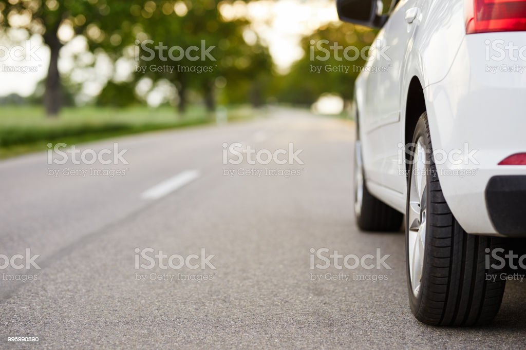 White car standing on the road - Foto stock royalty-free di Asfalto