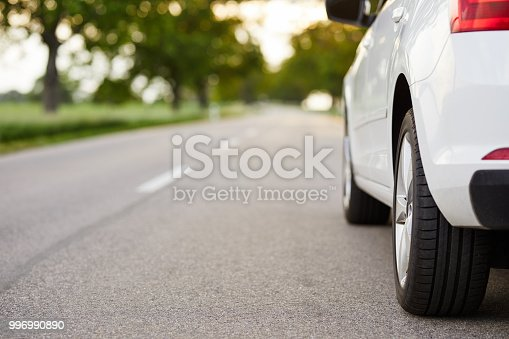 White car standing on the road with copy space