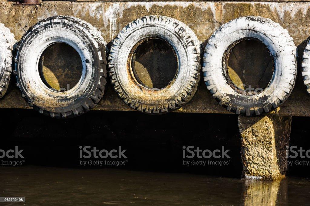 White car tires on pier stock photo
