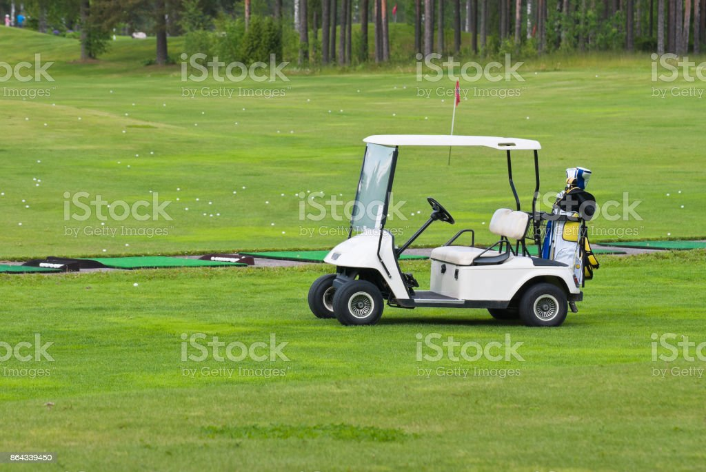 White car to get around the Golf course. stock photo
