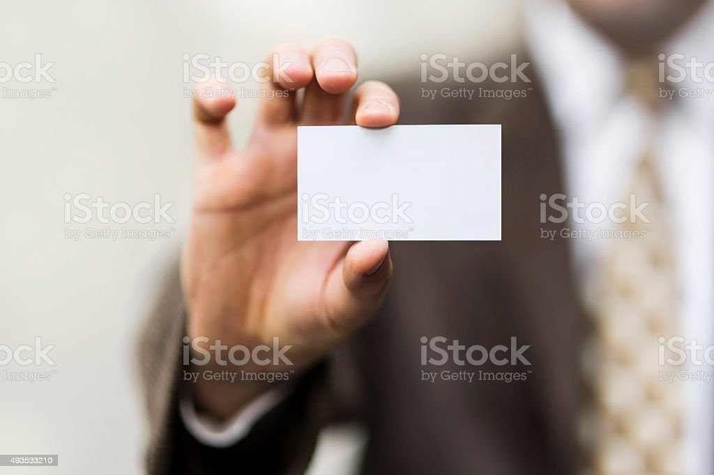 white card in hand stock photo
