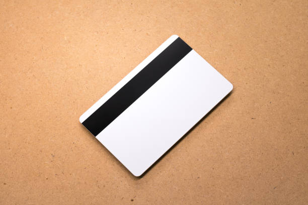 White card on wooden background. Template of blank credit card for your design. stock photo