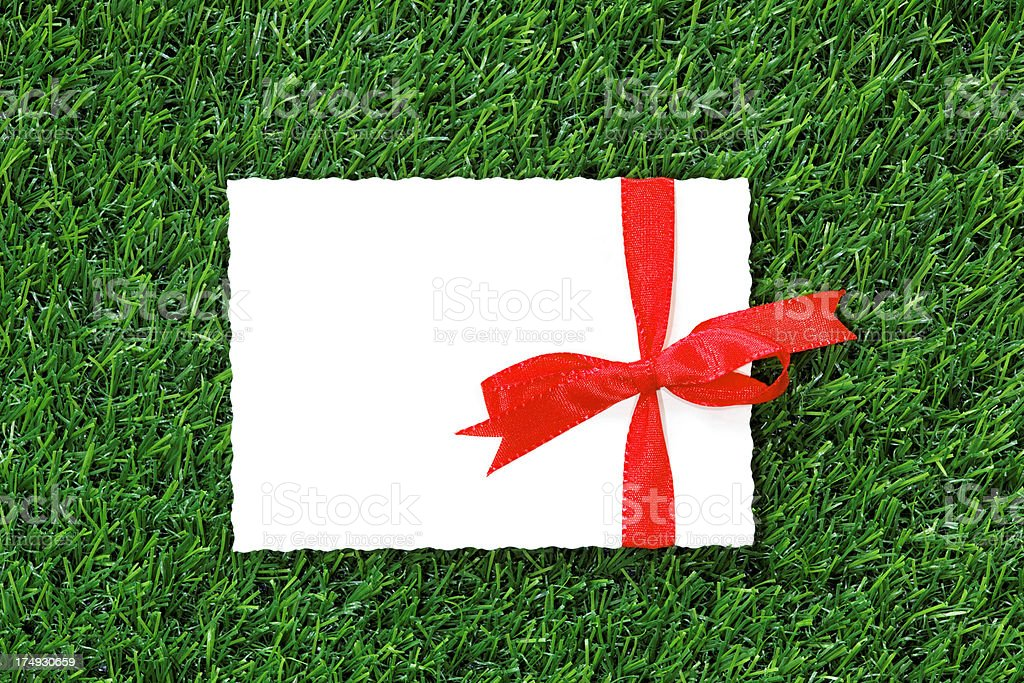 white card with space for text and red bow royalty-free stock photo