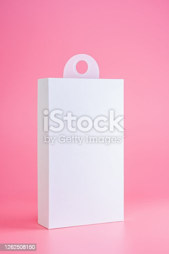 white cardboard package box mockup isolated on pink background with hanger