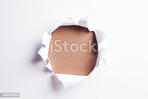 472273278 istock photo White card/paper with torn hole in the middle, colourful background 466238806