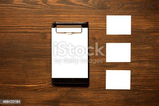 istock White cards on wooden desk 468420184