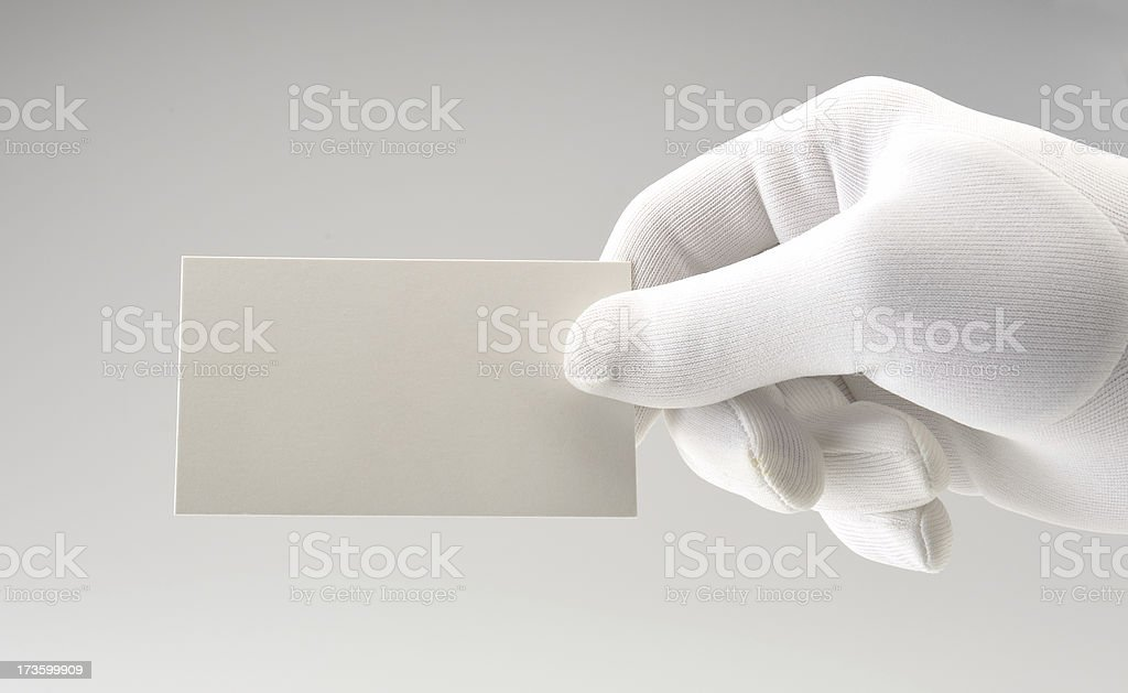 White card/white gloved hand/copy space stock photo