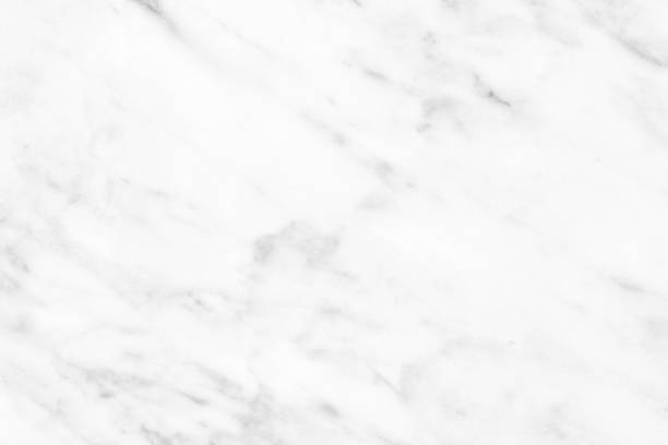 White Carrara Marble natural light surface for bathroom or kitchen countertop White Carrara Marble natural light for bathroom or kitchen white countertop. High resolution texture and pattern. marbled effect stock pictures, royalty-free photos & images