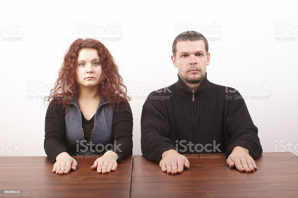 White casual couple sitting at the casual table - Royalty-free Adult Stock Photo