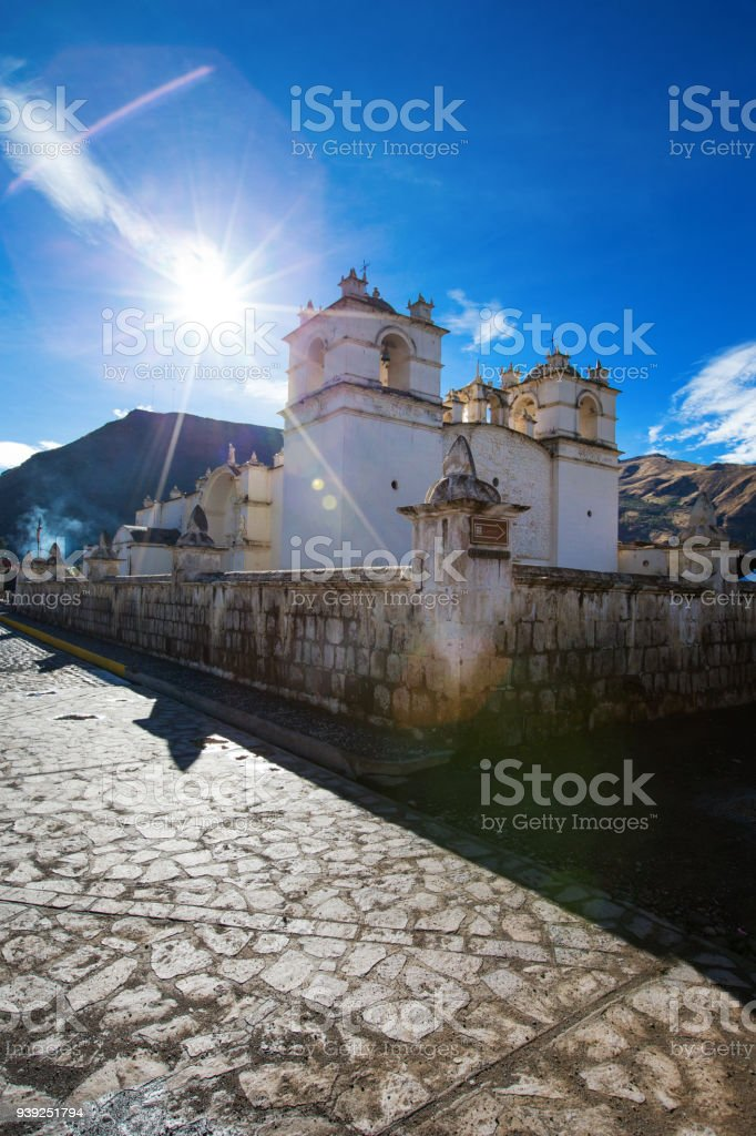 White Catholic church in rural Peru stock photo